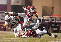 STAFF PHOTO ANTHONY REYES &bull; @NWATONYR<br /> Arkansas' Rohan Gaines (26) leapes over teammate Dwayne Eugene as he tackles Luke Eakes (83) of Northern Illinois University in the second half Saturday, Sept. 20, 2014 at Razorback Stadium in Fayetteville. The Razorbacks won 52-14.