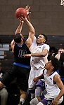 SIOUX FALLS, SD - MARCH 12:  Aziz Leeks #22 from the College of Idaho blocks the shot attempt by Chandler White #10 from St. Francis during their semifinal game at the 2018 NAIA DII Men's Basketball Championship at the Sanford Pentagon in Sioux Falls. (Photo by Dave Eggen/Inertia)