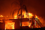 Nov 13, 2008 - Santa Barbara, California, USA -  A home is fully engulfed by flames at the Tea Fire , which broke out in the early evening in Montecito and moved into Santa Barbara, the fast-moving blaze driven by strong winds has burned 80 homes, 800 acres and forced evacuations in the wealthy Santa Barbara County community..(Credit Image: © Jonathan Alcorn/ZUMA Press)
