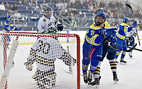 Delaware's (32) is inadvertently tripped after a goal. Delaware defeated Navy 8-3 at McMullen Hockey Arena.<br /> <br /> Photo by Randy Litzinger