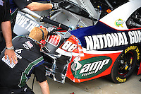 May 1, 2009; Richmond, VA, USA; Crew members for NASCAR Sprint Cup Series driver Dale Earnhardt Jr survey the damage to the car after a crash during practice for the Russ Friedman 400 at the Richmond International Raceway. Mandatory Credit: Mark J. Rebilas-