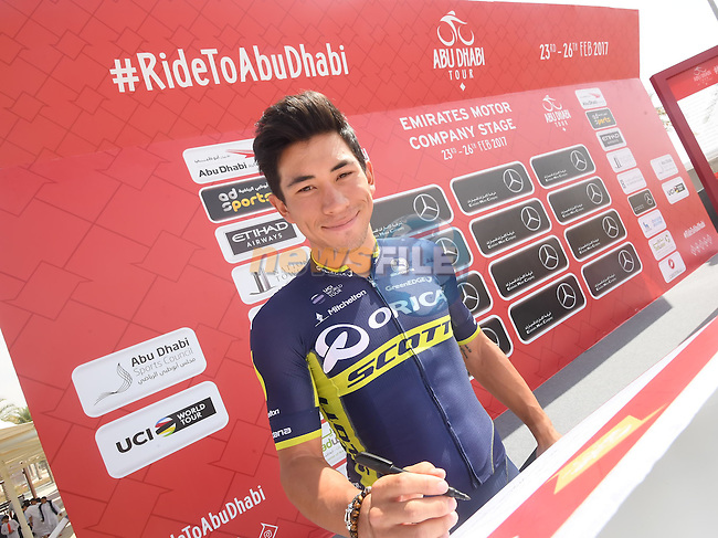 Caleb Ewan (AUS) Orica-Scott signs on before the start of Stage 1 Emirates Motor Company Stage of the 2017 Abu Dhabi Tour, running 189km from Madinat Zayed through the desert and back to Madinat Zayed, Abu Dhabi. 23rd February 2017<br /> Picture: ANSA/Matteo Bazzi | Newsfile<br /> <br /> <br /> All photos usage must carry mandatory copyright credit (&copy; Newsfile | ANSA)