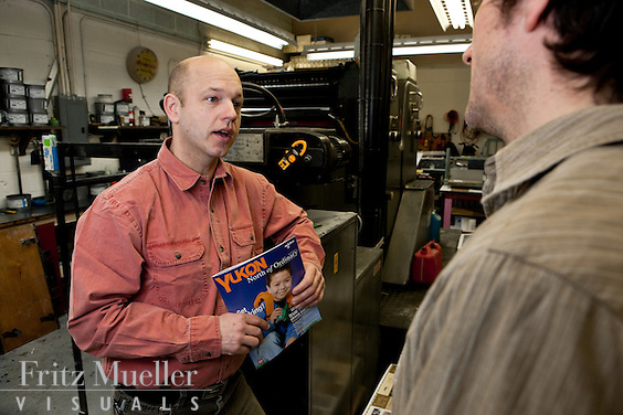 Greg Karais of Harper Street Publishing does a press check of his magazine North of Ordinary