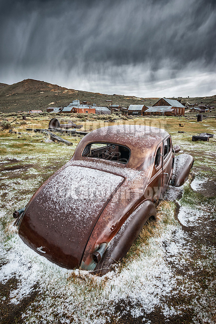 A coating of graupel (soft hail) on a rusty 1930s Pontiac coupe in the ghost town of Bodie, California, State Historic Park.