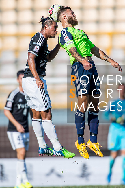 Wai Chuen So of Sun Pegasus FC (L) Vincent Lucas Weijl of Wofoo Tai Po (R) during the HKFA Premier League between Wofoo Tai Po vs Sun Pegasus at the Tai Po Sports Ground on 22 November 2014 in Hong Kong, China. Photo by Aitor Alcalde / Power Sport Images