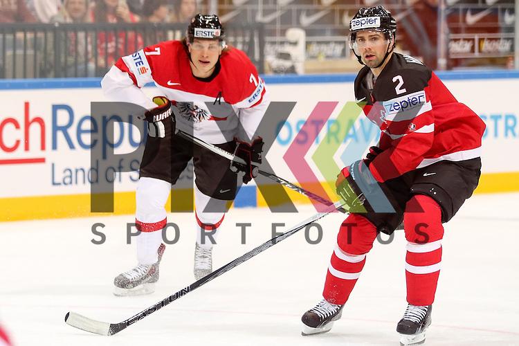 Oestereichs Lebler, Brian (Nr.7) im Zweikampf mit Canadas Hamhuis, Dan (Nr.2)  im Spiel IIHF WC15 Kanada vs. Oestereich.<br /> <br /> Foto &copy; P-I-X.org *** Foto ist honorarpflichtig! *** Auf Anfrage in hoeherer Qualitaet/Aufloesung. Belegexemplar erbeten. Veroeffentlichung ausschliesslich fuer journalistisch-publizistische Zwecke. For editorial use only.