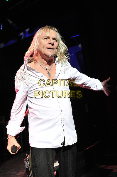 Bernie Shaw.Uriah Heep performing live in concert, Shepherd's Bush Empire, London, England. .8th December 2011.on stage gig performance music half length white shirt   .CAP/MAR.© Martin Harris/Capital Pictures.