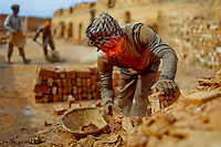 A Bangladeshi man works at a brick field in Savar, near Dhaka, Bangladesh. Emission of huge quantity of toxic elements from brick kilns is causing serious health hazards to workers and people living in surrounding areas with most suffering from respiratory or skin problems. Workers in this brick field earn less than $4 a day.