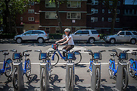 "Bicycle enthusiast uses a Citibike in the Chelsea neighborhood of New York on Monday, May 27, 2013 on the first day of the city's bike-sharing program. 6000 bikes in over 300 stations have been placed so far for the roll out of the program. Cyclists purchased one-year passes for $95 which gives them unlimited 45 minute rides to get from point ""A"" to point ""B"". Daily and hourly passes will soon be available.  (© Richard B. Levine)"