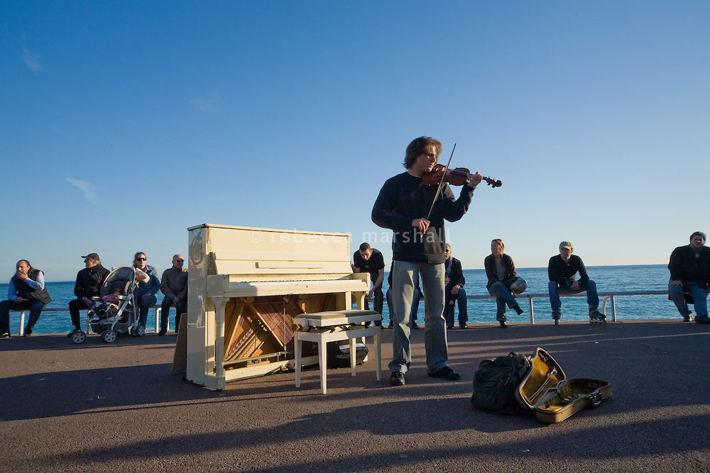 Evening busker, Promenade des Anglais, Nice, France, 8 March 2009.