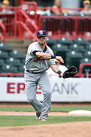 Binghamton Mets third baseman Dustin Lawley (24) throws to first during a game against the Erie Seawolves on July 13, 2014 at Jerry Uht Park in Erie, Pennsylvania.  Binghamton defeated Erie 5-4.  (Mike Janes/Four Seam Images)