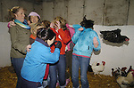 10th February, 2007. Organised hen parties (human ones) run by Deirdre Murtagh at her farm, Causey Farm, Kells, County Meath. Pauline Sharkey (Ardee, County Louth) and the cock that got away with her mates on the farm.Photo: BARRY CRONIN/Newsfile.(Photo credit should read BARRY CRONIN/NEWSFILE)