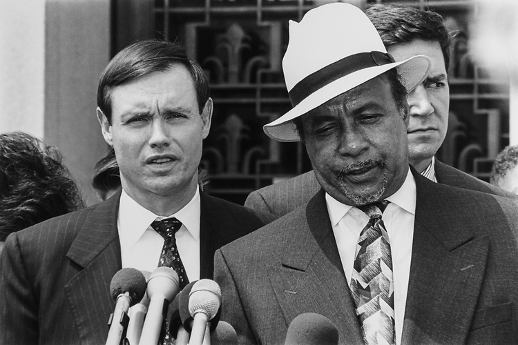 Dan K. Webb and Kenneth Mundy (left) defense lawyers for Rosty's case talk to Press in U.S. District Court, on July, 1994. (Photo by Laura Patterson/CQ Roll Call)
