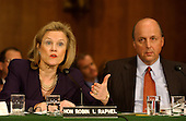 Robin L. Raphel, Coordinator, Office of Iraq Reconstruction, Department of State, Washington, DC, left, testifies at a hearing of the United States Senate Foreign Relations Committee to review the United Nations Oil-for-Food Program in Washington, D.C. on April 7, 2004.  United States United Nations Ambassador John Negroponte looks on from right..Credit: Ron Sachs / CNP.