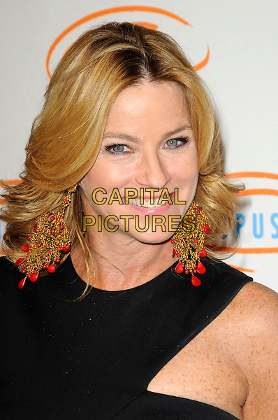 DOROTHY LUCEY.Lupus LA's 7th Annual Bag Ladies Luncheon to raise funds for lupus research at the Beverly Wilshire Four Seasons Hotel in Beverly Hills, California, USA..November 18th, 2009.headshot portrait black dangling gold orange earrings red.CAP/ROT.©Lee Roth/Capital Pictures