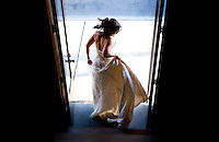 Michelle tugs on her wedding dress as she stands at the stairwell entrance to The Attic in Sumner, WA.(Photo by Scott Eklund/Red Box Pictures)