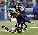 Seattle Seahawks wide receiver Golden Tate (81) breaks an attempted tackle by Jacksonville Jaguars linebacker Russell Allen (50) and runs for a 20-yard gain after catching a  pass from quarterback Russell Wilson for a first down during the second quarter at CenturyLink Field in Seattle, Washington on September 22, 2013. The Seahawks beat the Jaguars 45-17. ©2013. Jim Bryant Photo. ALL RIGHTS RESERVED.