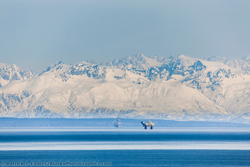 Oil drilling platforms in the Cook Inlet near Anchorage, Alaska. Aleutian mountain range, Alaska Peninsula, Southcentral, Alaska.