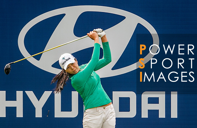 Mi-Jung Hur of Korea in action during the Hyundai China Ladies Open 2014 Pro-am on December 10 2014 at Mission Hills Shenzhen, in Shenzhen, China. Photo by Xaume Olleros / Power Sport Images