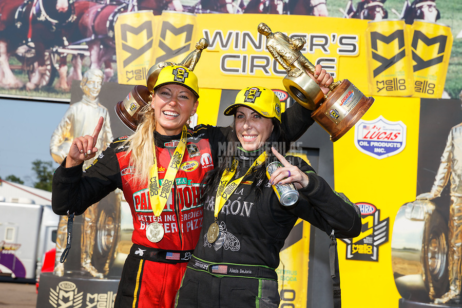 Aug 20, 2017; Brainerd, MN, USA; NHRA top fuel driver Leah Pritchett (left) and funny car driver Alexis DeJoria celebrate after becoming the first women to sweep the nitro classes at an NHRA event during the Lucas Oil Nationals at Brainerd International Raceway. Mandatory Credit: Mark J. Rebilas-USA TODAY Sports
