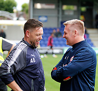 Former team mates Ashley Bayes (L) and Brentford manager, Dean Smith catch up during the Carabao Cup match between AFC Wimbledon and Brentford at the Cherry Red Records Stadium, Kingston, England on 8 August 2017. Photo by Carlton Myrie.