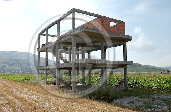 Korca/Korce-Albania - August 03, 2004---Construction of a house in the middle of nowhere, seen these days as a phenomenon allover the country; economy-infrastructure-environment---Photo: Horst Wagner/eup-images
