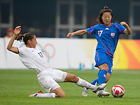 Japanese forward (17) Yuki Nagasato is tackled by New Zealand defender (17) Marlies Oostdam during first round play in the 2008 Beijing Olympics at Qinhuangdao, China. .  Japan tied New Zealand, 2-2, at Qinhuangdao Stadium.