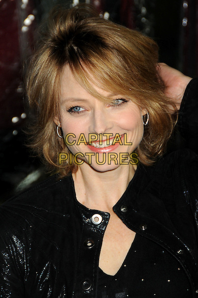 "JODIE FOSTER .Attending the ""Edge of Darkness"" Los Angeles Premiere held at Grauman's Chinese Theatre, Hollywood, California, USA, 26th January 2010..arrivals portrait headshot black silver hoop earrings make-up hand on touching head hair  smiling .CAP/ADM/BP.©Byron Purvis/AdMedia/Capital Pictures."