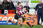 Tim Nanai Williams tackles Mark Wells.  ITM Cup & Ranfurly Shield rugby match between the Counties Manukau Steelers and the Southland Stags played at Rugby Park, Invercargill, on Saturday 14th of August, 2010..Southland won the game 13 - 9 after leading 11 - 6 at halftime.