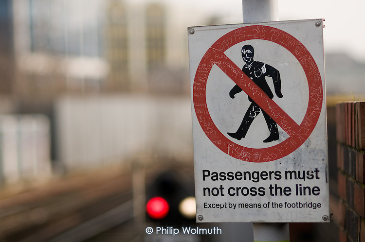 Warning sign at Stratfrod station, London.