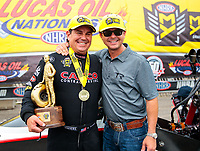 Aug 19, 2018; Brainerd, MN, USA; NHRA top fuel driver Billy Torrence (left) celebrates with son Steve Torrence after winning the Lucas Oil Nationals at Brainerd International Raceway. Mandatory Credit: Mark J. Rebilas-USA TODAY Sports