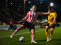 Lincoln City's Matt Rhead vies for possession with Wolverhampton Wanderers U21's Ryan Giles<br /> <br /> Photographer Chris Vaughan/CameraSport<br /> <br /> The EFL Checkatrade Trophy Northern Group H - Lincoln City v Wolverhampton Wanderers U21 - Tuesday 6th November 2018 - Sincil Bank - Lincoln<br />  <br /> World Copyright © 2018 CameraSport. All rights reserved. 43 Linden Ave. Countesthorpe. Leicester. England. LE8 5PG - Tel: +44 (0) 116 277 4147 - admin@camerasport.com - www.camerasport.com