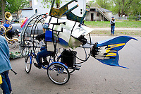Tricycle fish mobile representing the creatures that live in the water. MayDay Parade and Festival. Minneapolis Minnesota USA