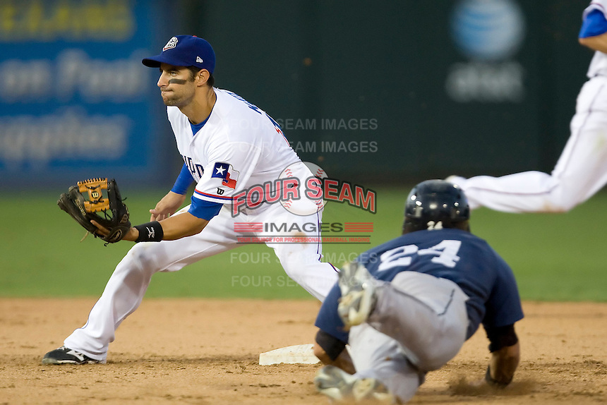 Round Rock Express second baseman Matt Kata #15 waits for the catchers throw during a steal attempt during a game against the New Orleans Zephyrs at the Dell Diamond on July 21, 2011 in Round Rock, Texas.  New Orleans defeated Round Rock 7-4.  (Andrew Woolley/Four Seam Images)