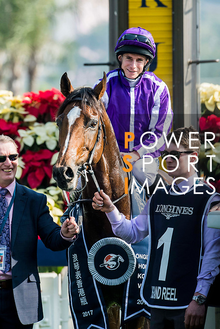 Jockey Ryan Moore riding Highland Reel celebrates after wining the Longines Hong Kong Vase (G1, 2400m) during the Longines Hong Kong International Races at Sha Tin Racecourse on December 10 2017, in Hong Kong, Hong Kong. Photo by Victor Fraile / Power Sport Images