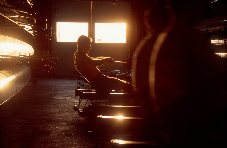 Sports, Rowing, Man on a rowing machine in a boathouse. Male athlete erging on an ergonometer in blur motion, winter, MIT boathouse, Cambridge, Massachusetts, New England, USA.