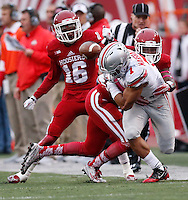 Indiana Hoosiers linebacker Zeke Walker (6) causes Ohio State Buckeyes running back Jalin Marshall (7) to fumble   in the 4th quarter  of an NCAA football game between the Ohio State Buckeyes and the Indiana Hoosiers at Memorial Stadium in Bloomington, Indiana, on Saturday, October 3, 2015. Also pictured is Indiana Hoosiers defensive back Rashard Fant (16) (Columbus Dispatch photo by Fred Squillante)