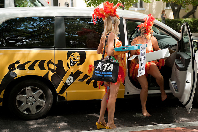 "PETA's scantily-clad ""chicks"" in tall ""feather"" headdresses and bikinis get out of a PETA minivan to hand out egg-free recipes and eggless treats near the White House on Aug. 25, 2010. The event was in response to the recall of half a billion eggs during a salmonella outbreak."