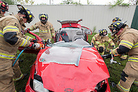 NWA Democrat-Gazette/J.T. WAMPLER Rogers firefighters use various tools to cut a vehicle apart Wednesday Sept. 9, 2015 during extrication exercises. The department does similar training  throughout the year as opportunities allow. The training allows firefighters to try out new techniques and keep familiar with the equipment used to remove vehicle occupants after accidents.