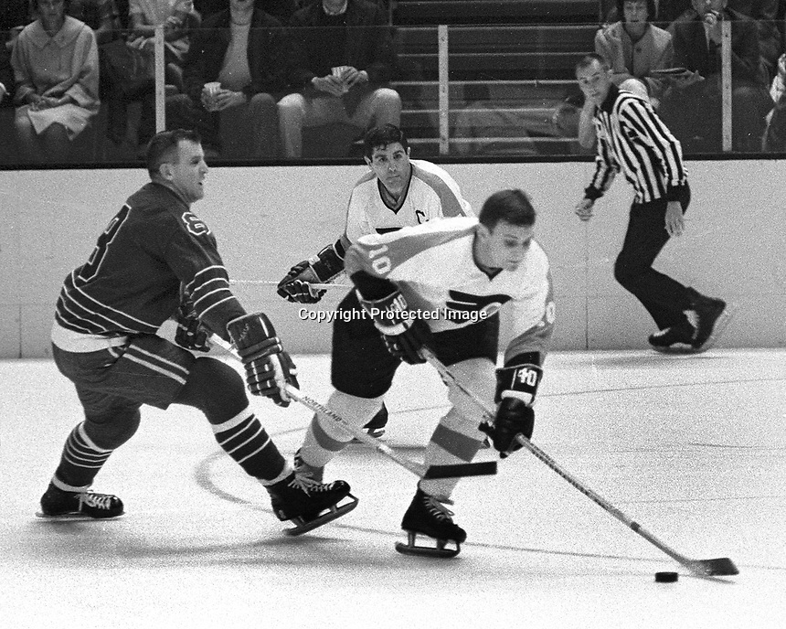 Seals opening game 1967, Seals Gerry Ehman and Flyers Brit Selby.photo by Ron Riesterer