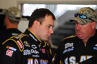 Feb 11, 2009; Daytona Beach, FL, USA; NASCAR Sprint Cup Series driver Ryan Newman (left) talks with crew chief Tony Gibson during practice for the Daytona 500 at Daytona International Speedway. Mandatory Credit: Mark J. Rebilas-
