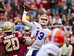 Florida quarterback Feleipe Franks (13) trows against Florida State in the 1st half of an NCAA college football game in Tallahassee, Fla., Saturday, Nov. 24, 2018. (AP Photo/Mark Wallheiser)