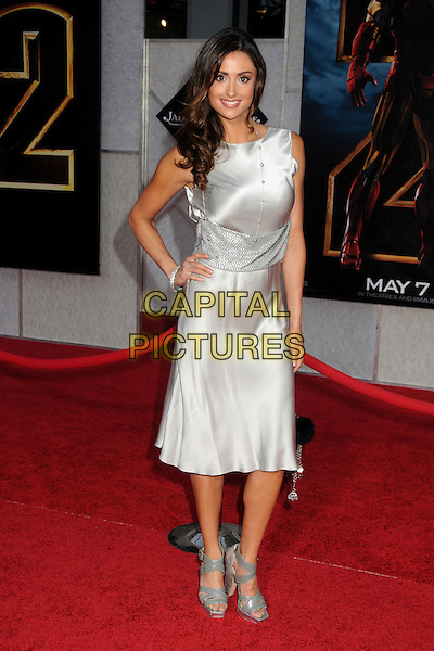 "KATIE CLEARY .""Iron Man 2"" World Premiere held at the El Capitan Theatre, Hollywood, California, USA, 26th April 2010..arrivals full length silver dress sleeveless hand on hip shiny open toe grey gray patent sandals clutch bag .CAP/ADM/BP.©Byron Purvis/AdMedia/Capital Pictures."