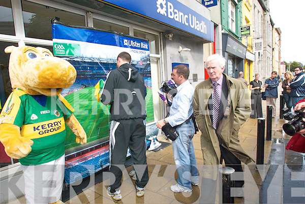 STAR: Dominic Regan, Kilmoyley, with his grandmother Nora Kelly, Tralee, pictured  with Kieran 'Star' Donaghy outside the Ulster Bank on Saturday during the bank's All Ireland promotion.