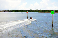 Jet Ski zooming from Boynton Beach, Florida, Intracoastal Park to the Intracoastal waterway at low tide. Note  the jet ski is leaving the marked channel. See next picture.