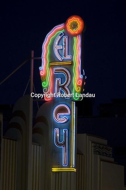 The Art Deco El Rey Theater neon sign on night.