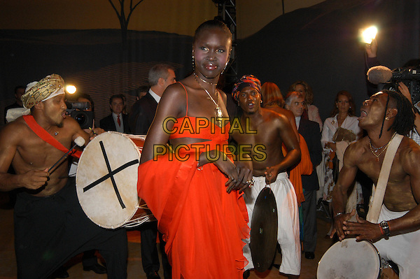 ALEK WEK.Opening of a new Cartier shop..palazzo caffarelli, Rome, Italy.September 22nd, 2005.half length red dress sheer criss cross band music drums.www.capitalpictures.com.sales@capitalpictures.com.© Capital Pictures.