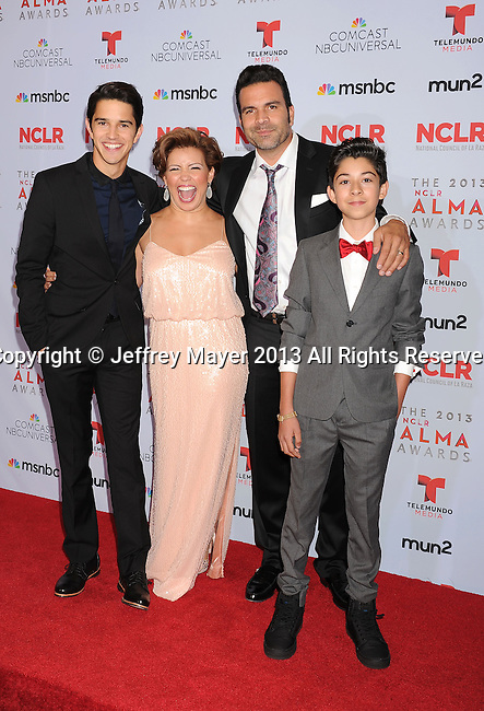 PASADENA, CA- SEPTEMBER 27: (L-R) Actors Joseph Haro, Justina Machado, Ricardo A. Chavira and Fabrizio Guido pose in the press room at the 2013 NCLA ALMA Awards at Pasadena Civic Auditorium on September 27, 2013 in Pasadena, California.