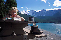 CANADA, ALBERTA, KANANASKIS, MAY 2002. A hiker takes a rest at the Upper Kananaskis Lake.  The Kananaskis Country provincial park is home to Canada's most beautiful nature and wildlife. It has also escaped the mass tourism as in Banff National Park. Photo by Frits Meyst/Adventure4ever.com