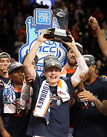 ANDREW SHURTLEFF/THE DAILY PROGRESS<br /> Virginia guard Kyle Guy (5) holds up a trophy for most valuable player after defeating North Carolina 71-63 to become ACC Tournament champions Saturday in Brooklyn, NY.
